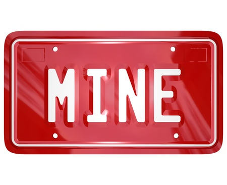 selfish: The word Mine on a red auto license vanity plate to illustrate ownership of an automobile Stock Photo