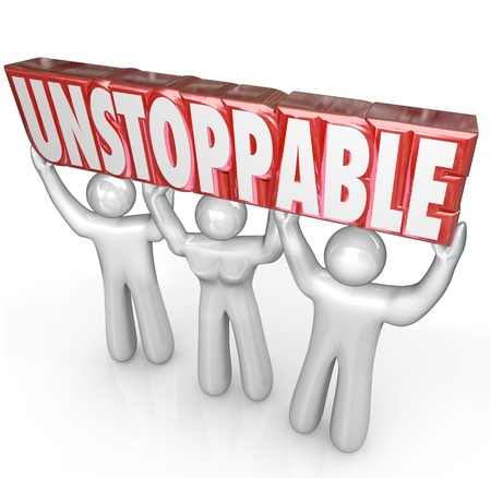 surpassing: A team of three people lifts the word Unstoppable to illustrate the concept of determination and working together without limits to achieve success Stock Photo