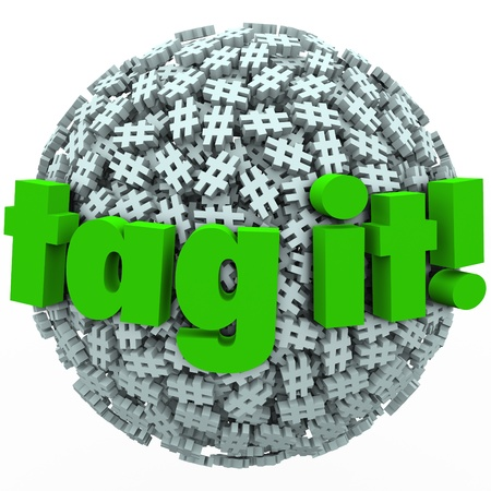 The words Tag It on a ball or sphere of hash tags to illustrate trending topics, posts or stories promoted with hashtags on news sites or social networks photo