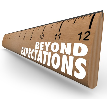 expectations: The words Beyond Expectations on a ruler to illustrate great results, good grades or other measurements met or surpassed in school, career or life goals Stock Photo