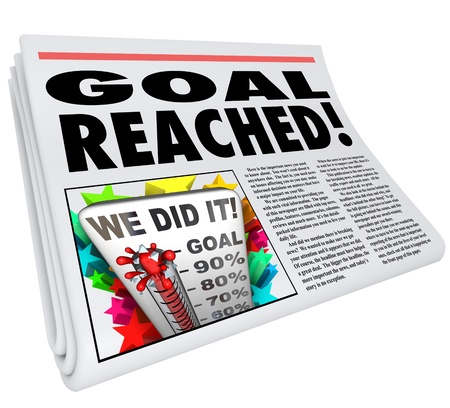 fundraiser: A newspaper headline Goal Reached and article with picture of thermometer with level at 100% and words We Did It Stock Photo