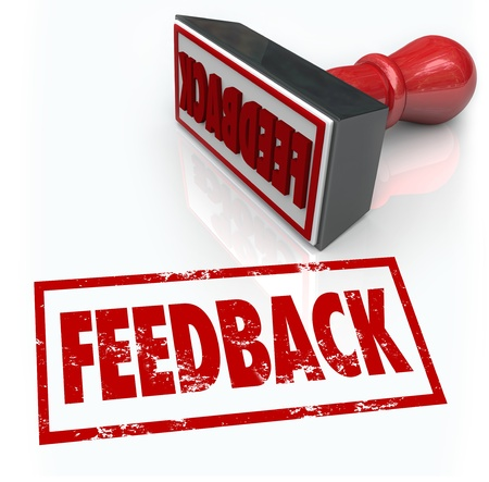 A red rubber stamp with the word Feedback to illustrate comments, reviews, criticism, opinions, judgment or approval photo