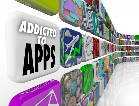 reliance: Addicted to Apps words on app tiles to illustrate our growing reliance on application and software on mobile devlices like smart phones and tablet computers Stock Photo