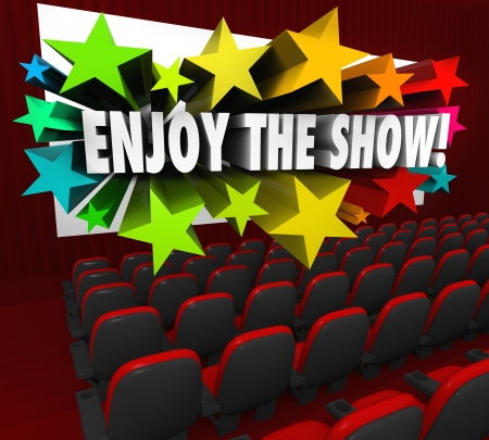The words Enjoy the Show on a movie screen in a theater to tell the audience to sit back and be entertained by a film or play Stock Photo - 21532181