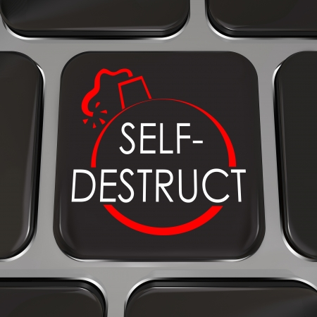 The words Self-Destruct and a bomb picture on a black computer keyboard key to illustrate giving up, quitting and admitting defeat photo