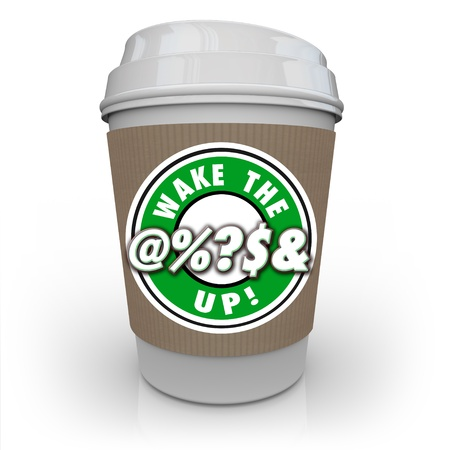swear: The words Wake the @%?S& Up on a cup of coffee to illustrate becoming alert, conscious and awake to problems and issues around you