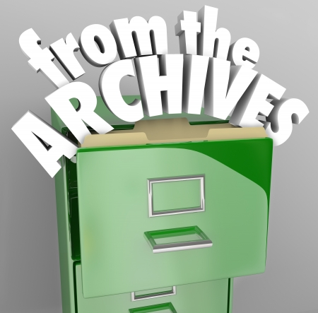A green file cabinet with the words From the Archives pulling out of an open drawer photo