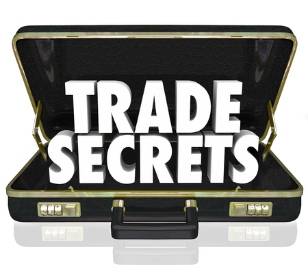 secret information: The words Trade Secrets in an opening black leather briefcase to illustrate proprietary information or intellectual property
