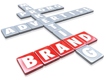 The word Brand on red letter tiles with other words such as Marketing, Advertise and Promo to illustrate the concepts of branding for a company or product Stock Photo - 21642417