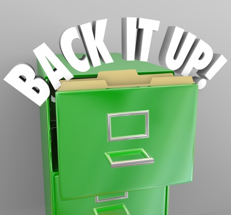 The words Back It Up in a filing cabinet to communicate a message of copying your important documents to keep vital information safe Stock Photo - 21777816
