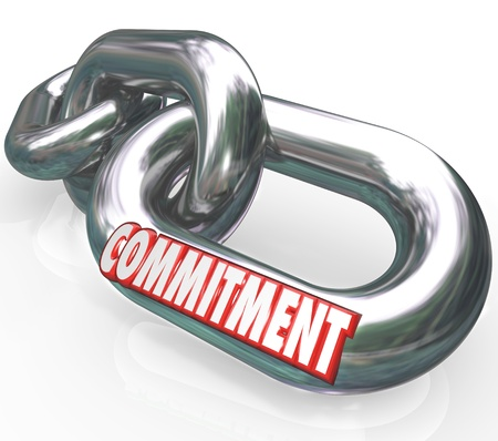 dedication: The word Commitment on chain links locked together to illustrate dedication, determination, promise, loyalty, trustworthiness and sincerity