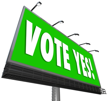 affirm: Vote Yes words on a big green outdoor billboard to encourage you to approve, affirm or accept a candidate or proposal