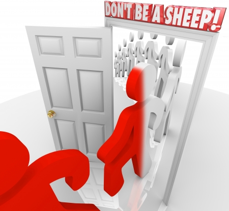 follow through: The words Dont Be a Sheep above a doorway as people march through and are changed, warning you to be independent, non-conformist and self-reliant