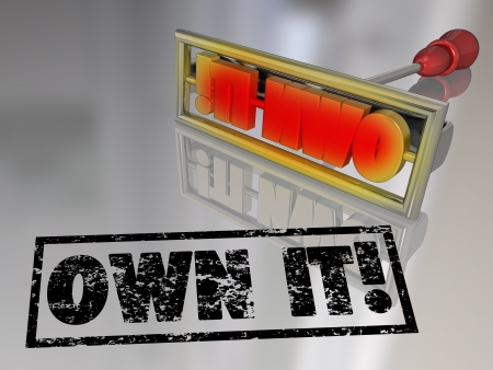 own: The words Own It on a branding iron to illustrate the concept of ownership and claiming responsibility