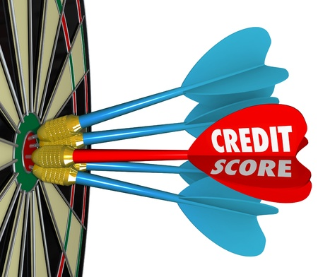 interests: The word Credit Score on a dart hitting the bulls-eye target on a dartboard to illustrate getting the best number or rating when securing financing or a loan