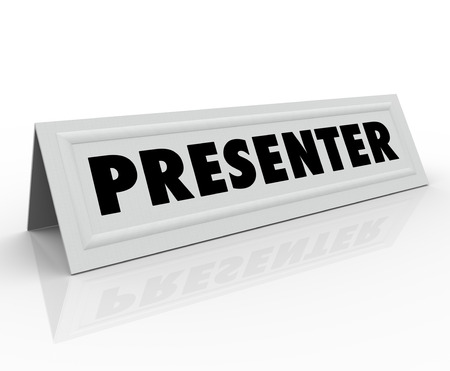 panelist: The word Presenter on a blank white name tent card to illustrate the role of a guest speaker or panelist at a conference, seminar or other event where a presentation is given Stock Photo