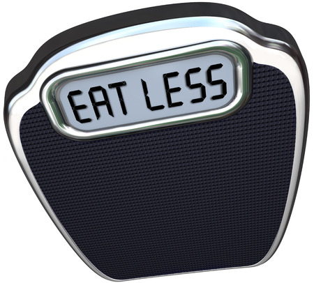 The words Eat Less on the display of a scale to illustrate losing weight on a diet by eating fewer calories and fatty foods Banco de Imagens