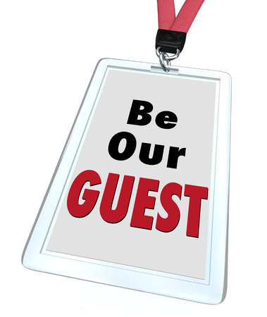 guests: Be Our Guest words on a badge with lanyard to illustrate welcome hospitality for a visitor or newcomer to a business, event, restaurant, destination or travel spot