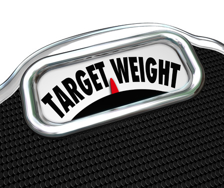 heavy weight: The words Target Weight on a scale display to illustrate weightloss and reaching a desired goal for fitness and health in eating less and exercise Stock Photo
