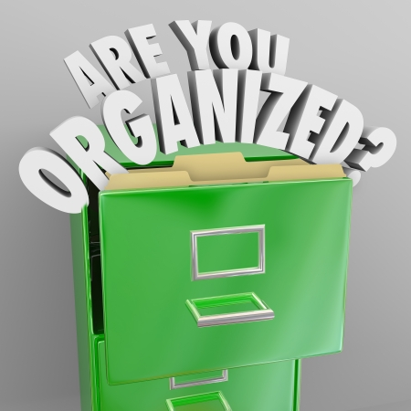 coming out: The words Are You Organized and quesiton mark coming out of a green metal filing cabinet to illustrate organization skills and the need to file your records in a neat manner