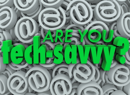 The words Are You Tech Savvy on a background of email at symbols or signs photo