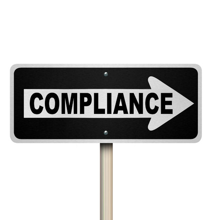 compliance: The word Compliance on a street sign pointing the way to complying with rules, guidelines, regulations and laws for your business or life