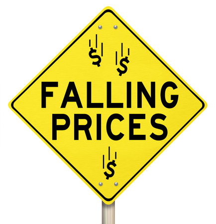 cut price: The words Falling Prices and dollar signs or symbols on a yellow warning sign to advertise reduced costs at a special clearnace sale or event Stock Photo