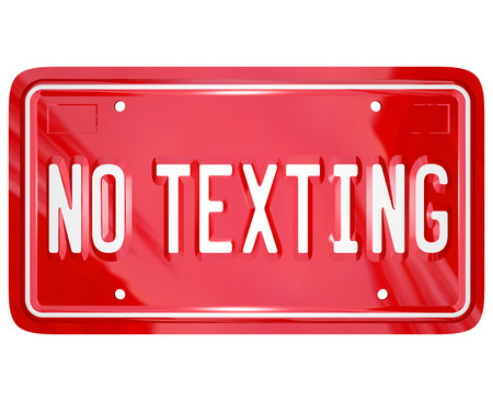 distraction: A red vanity license plate with the words No Texting to illustrate a warning about the dangers of text messaging while driving a car or other vehicle