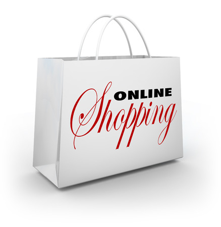 The words Online Shopping on a white shopping bag to illustrate buying goods and services on websites or web based stores Stock Photo - 22438335