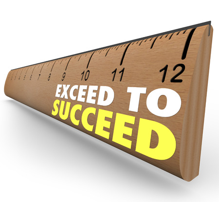 surpass: The words Exceed to Succeed on a wooden ruler from school to illustrate getting extra credit or going above and beyond expections to achieve success