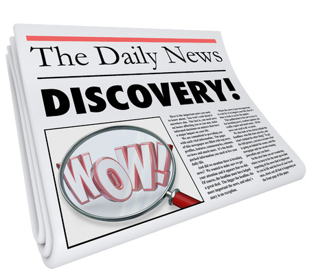 discovered: The word Discovery on a newspaper headline with photo of magnifying glass on word Wow to illustrate shocking or surprising news or announcement
