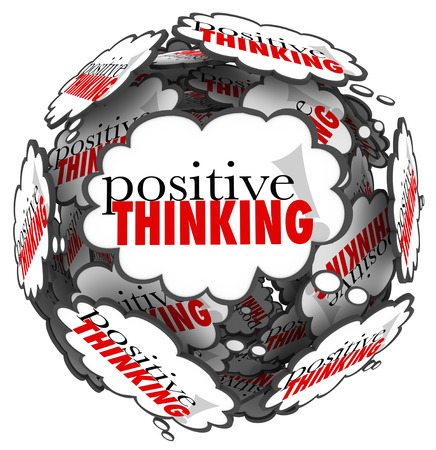 The words Positive Thinking in thought clouds to represent a great attitude being important to achieving success and accomplishing your goals photo