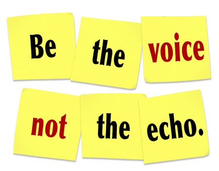 be: The words Be the Voice Not the Echo as a saying or quote printed on yellow sticky notes to inspire or motivate people to lead and not follow in setting the pace of change and innovation