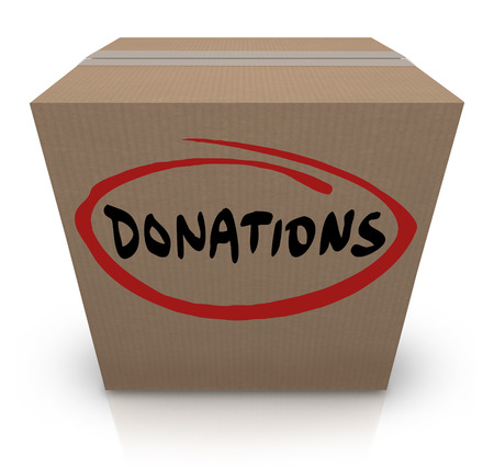 The word Donations on a cardboard box to illustrate a food or clothing drive for needy or homeless people or underprivileged in poverty stricken countries photo