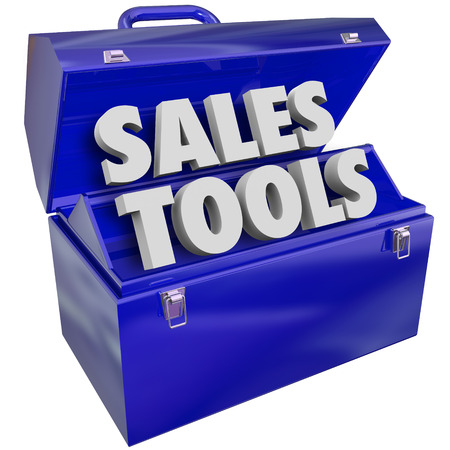 schemes: The words Sales Tools in a green metal toolbox to illustrate selling techniques, methods, schemes, plans or processes
