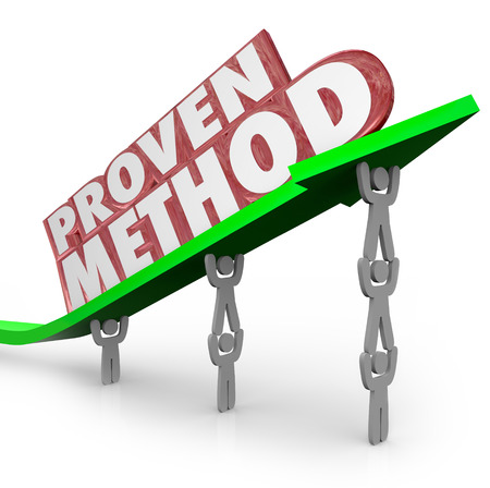 A team lifts an arrow with the words Proven Method to illustrate a time-tested process or procedure for achieving great results Stockfoto