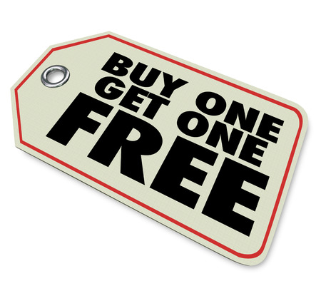 sales person: A price tag with words Buy One Get One Free to illustrate a special discount or clearance sale advertising a bogo promotion or savings on an item or service