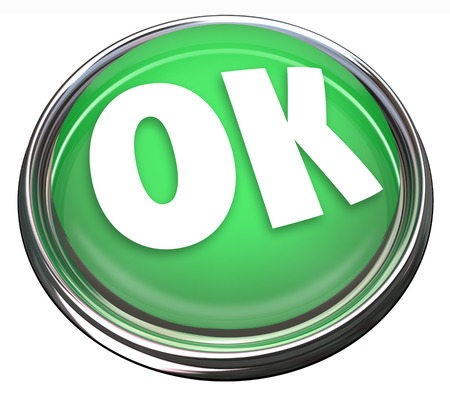 validating: The word OK on a green round button to illustrate approval or acceptance, or beginning or starting an initiative or project Stock Photo