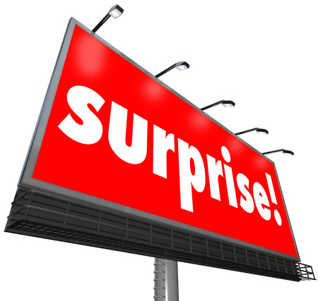 The word Surprise on a red outdoor billboard or banner sign to illustrate shock or a surprising discovery that is unexpected Stock Photo - 23348745