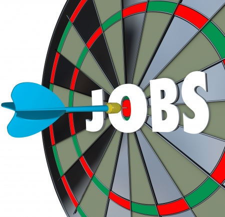 A dartboard with word Jobs and a dart in the bullseye to illustrate succeeding in a job search and landing work after searching in classifieds, applying and interviewing for a position