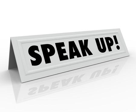 panelist: The words Speak Up on a paper tent or name card inviting you to share your thoughts, ideas, comments, feedback, review or opinion on an issue being discussed in an open forum or panel discussion Stock Photo