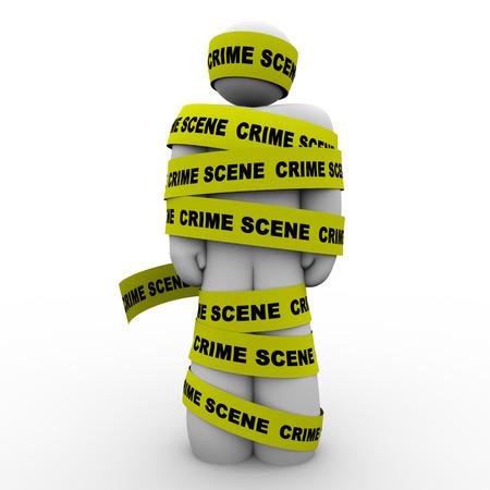 detained: Amarillo cinta de la escena del crimen wrpped en torno a un hombre o una persona sospechosa de un delito o acto criminal y sea arrestado o detenido por la polic�a para ser interrogados