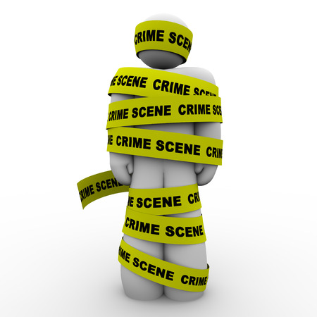 felony: Yellow crime scene tape wrpped around a man or person who is suspected of a felony or other criminal act and is arrested or detained by police for questioning
