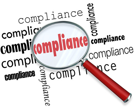 mitigate: Compliance words under magnifying glass to illustrate the importance of following rules, regulations and guidelines in your profession, at work or career to conform to legal requirements Stock Photo