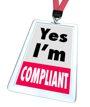 mitigate: Yes Im Compliant on a badge with lanyard to tell customers that you comply with important legal rules, regulations and guidelines to give them confidence that your practices are legitimate and safe Stock Photo