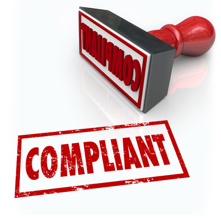 governing: Compliance word in rubber stamp of approval as a result of your audit, assessment or evaluation on how your company or business follows rules and regulations in its procedures Stock Photo