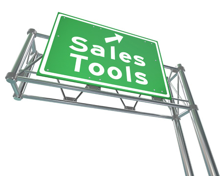 sales process: Sales Tools green freeway road sign to point you to selling or marketing techniques to drive more closed deals