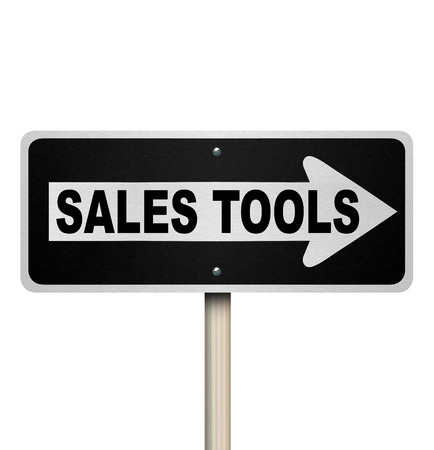 business pitch: Sales Tools words on a one-way road sign with arrow pointing to new and innovative selling techniques that promise to help you reach your goals Stock Photo