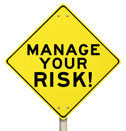 risks icon: Manage Your Risk words on a yellow warning road sign to illustrate the need to reduce danger and opportunity for loss or liability in your life or business Stock Photo
