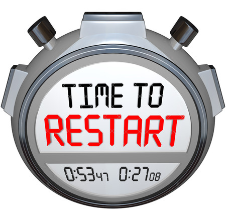 revitalization: Time to Restart on a stopwatch or timers to illustrate a redo, rebuild, refresh, renew, revitalization or reinvention of your life, career or company